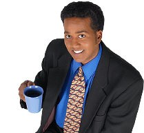 Smiling businessman drinking mug of coffee